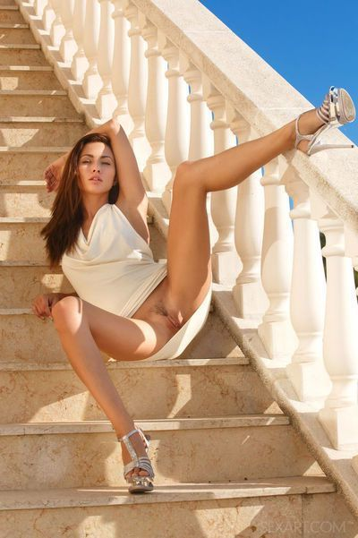 Dress clad Michaela Isizzu giving naked upskirt & spreading pussy in public