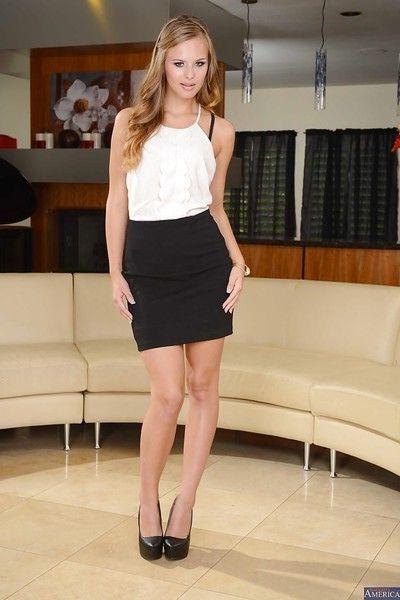 Beautiful babe with long legs Jillian Janson poses in high heels