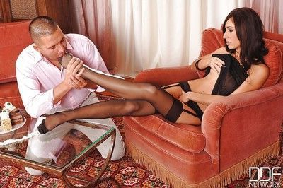 Hot brunette chick Eloa Lombard giving footjob with nylon encased feet