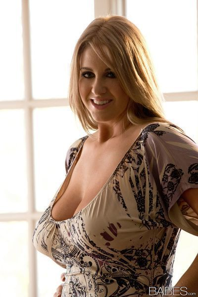 Solo girl Rockell Starbux unveiling massive tits before masturbating