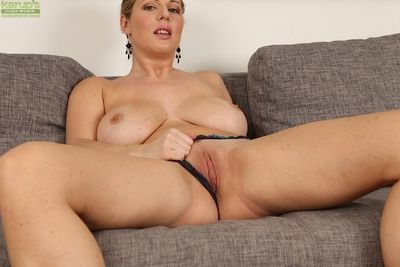 Buxom mature woman Britney masturbating freshly trimmed pussy