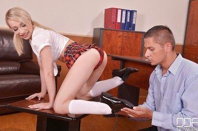 Young blond Euro schoolgirl Chessie Kay using barefeet to jerk teacher dick